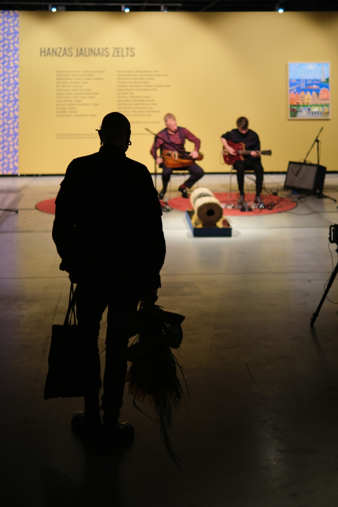 My painting used as a backdrop for traditional music in Riga.